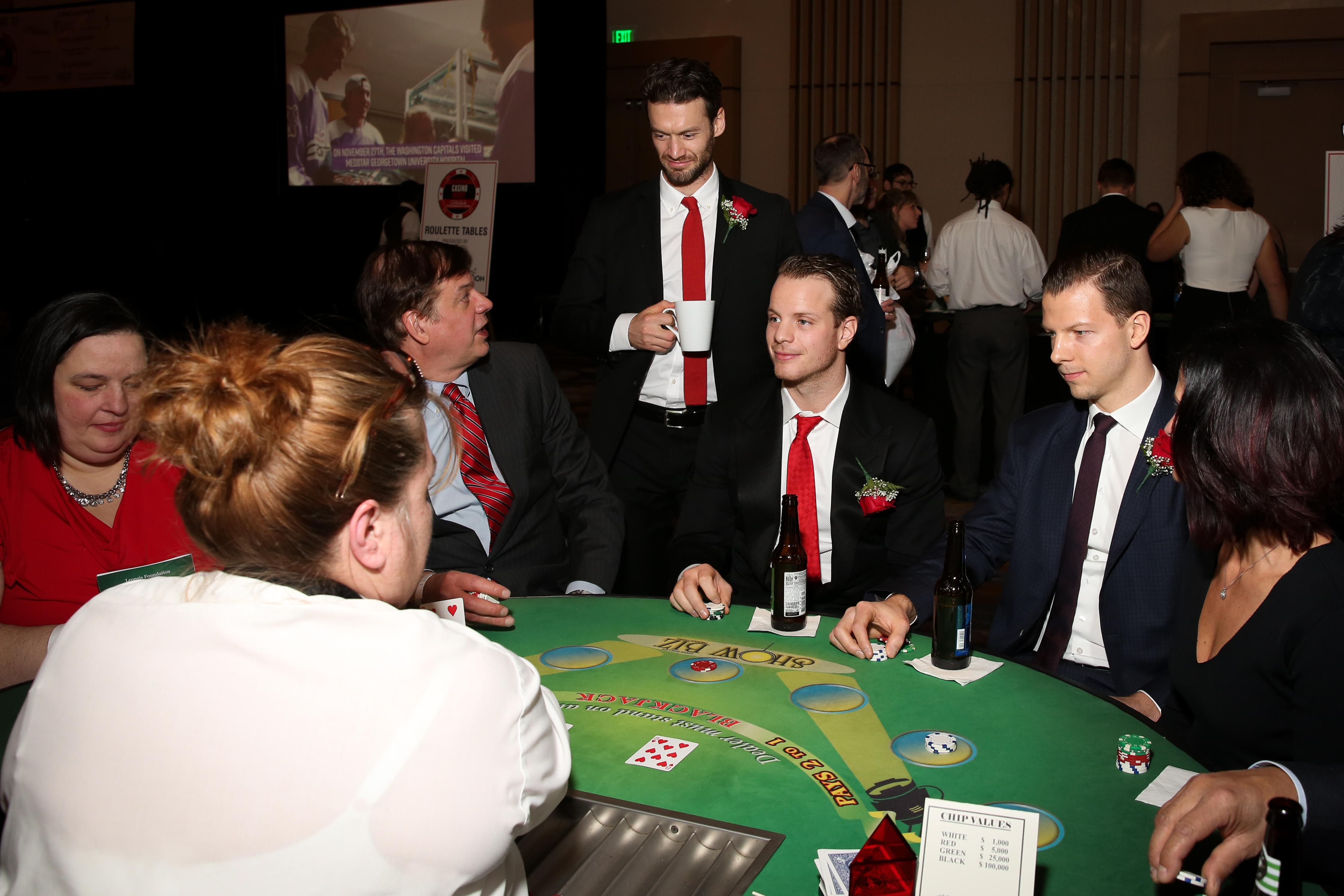 Players from the Washington Capitals mingled with fans at their annual Casino Night, which was held at MGM National Harbor, on January 4. The proceeds of the evening  went to charity and gave fans a chance to get up close and personal with their favorite hockey players over the poker table. (Amanda Andrade-Rhoades/DC Refined)