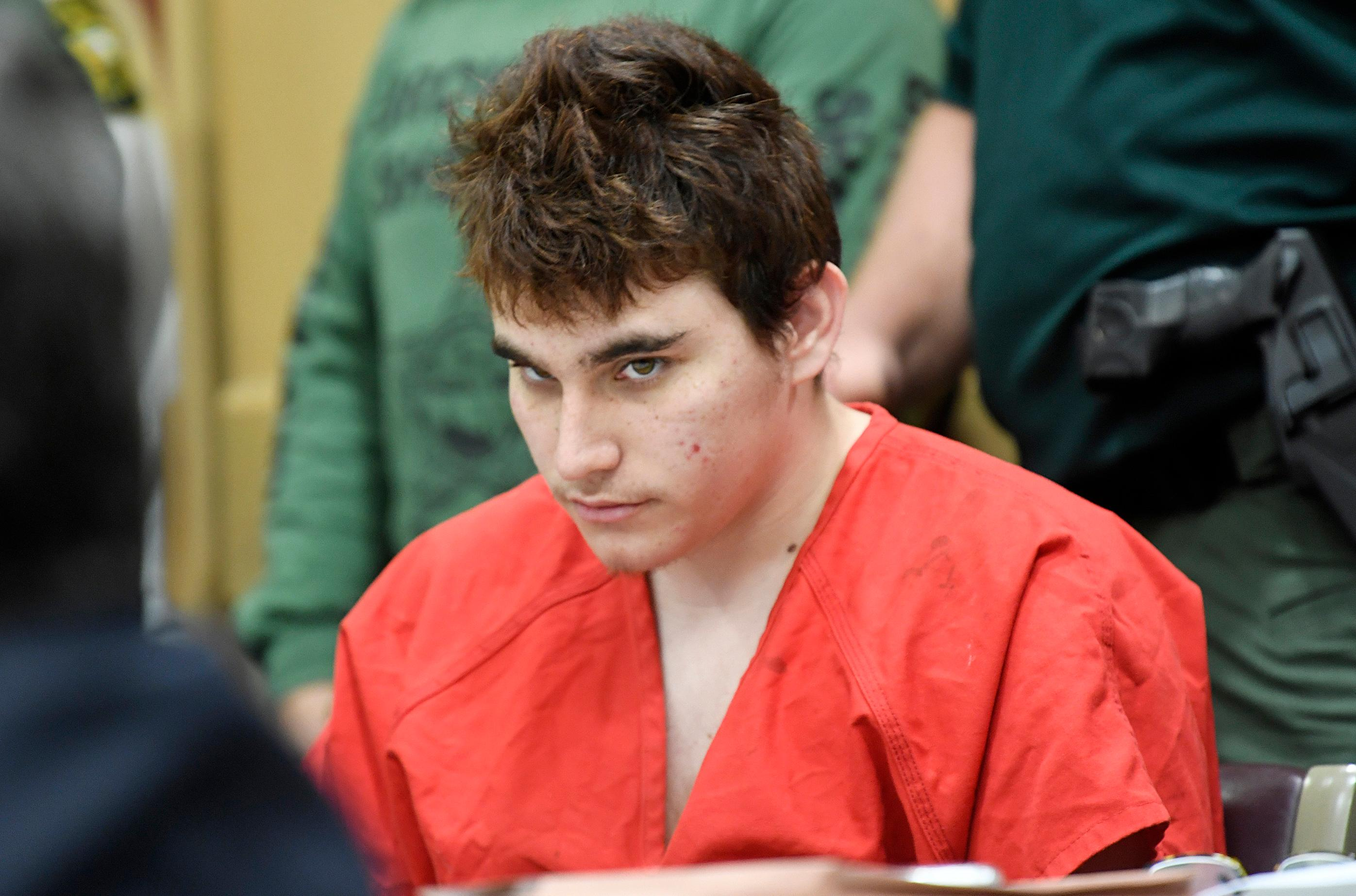 FILE- Florida school shooting suspect Nikolas Cruz, looks up while in court for a hearing in Fort Lauderdale, Fla., Friday, April 27, 2018.{ } (Taimy Alvarez/South Florida Sun-Sentinel via AP, Pool)