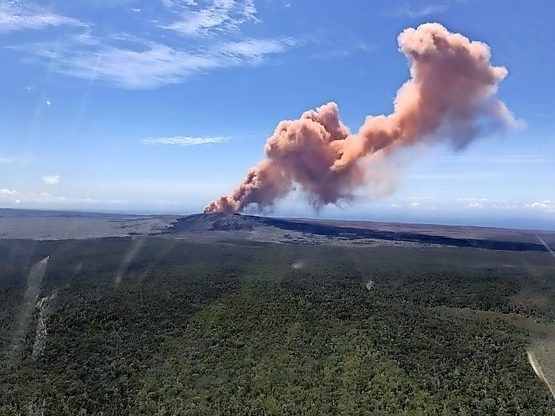 In this photo released by U.S. Geological Survey, ash plume rises above the Puu Oo vent, on Hawaii's Kilaueaa Volcano Thursday, May 3, 2018 in Hawaii Volcanoes National Park. Nearly 1,500 residents were ordered to evacuate from their volcano-side homes after Hawaii's Kilauea Volcano erupted, sending molten lava to chew its way through forest land and bubble up on paved streets. (U.S. Geological Survey via AP)