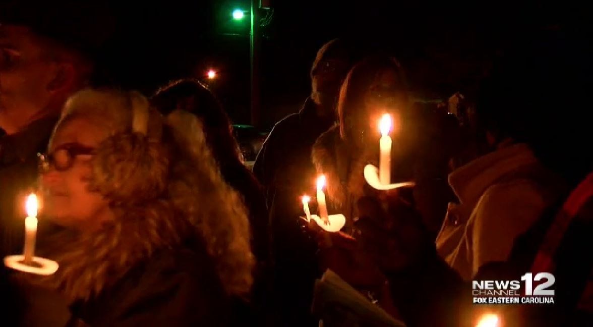 Local community members gather for a vigil in honor of Mariah Woods. (Greg Payne, NewsChannel 12 photo)<p></p>