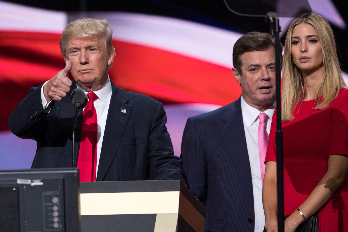 In this photo taken July 21, 2016, then-Trump Campaign manager Paul Manafort stands between the then-Republican presidential candidate Donald Trump and his daughter Ivanka Trump during a walk through at the Republican National Convention in Cleveland. Manafort, secretly worked for a Russian billionaire to advance the interests of Russian President Vladimir Putin a decade ago and proposed an ambitious political strategy to undermine anti-Russian opposition across former Soviet republics, The Associated Press has learned. (AP Photo/Evan Vucci)