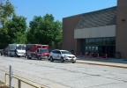 Emergency vehicles are parked outside Preble High School in Green Bay, Aug. 8, 2014, after an early-morning fire. (WLUK/Ben Krumholz)