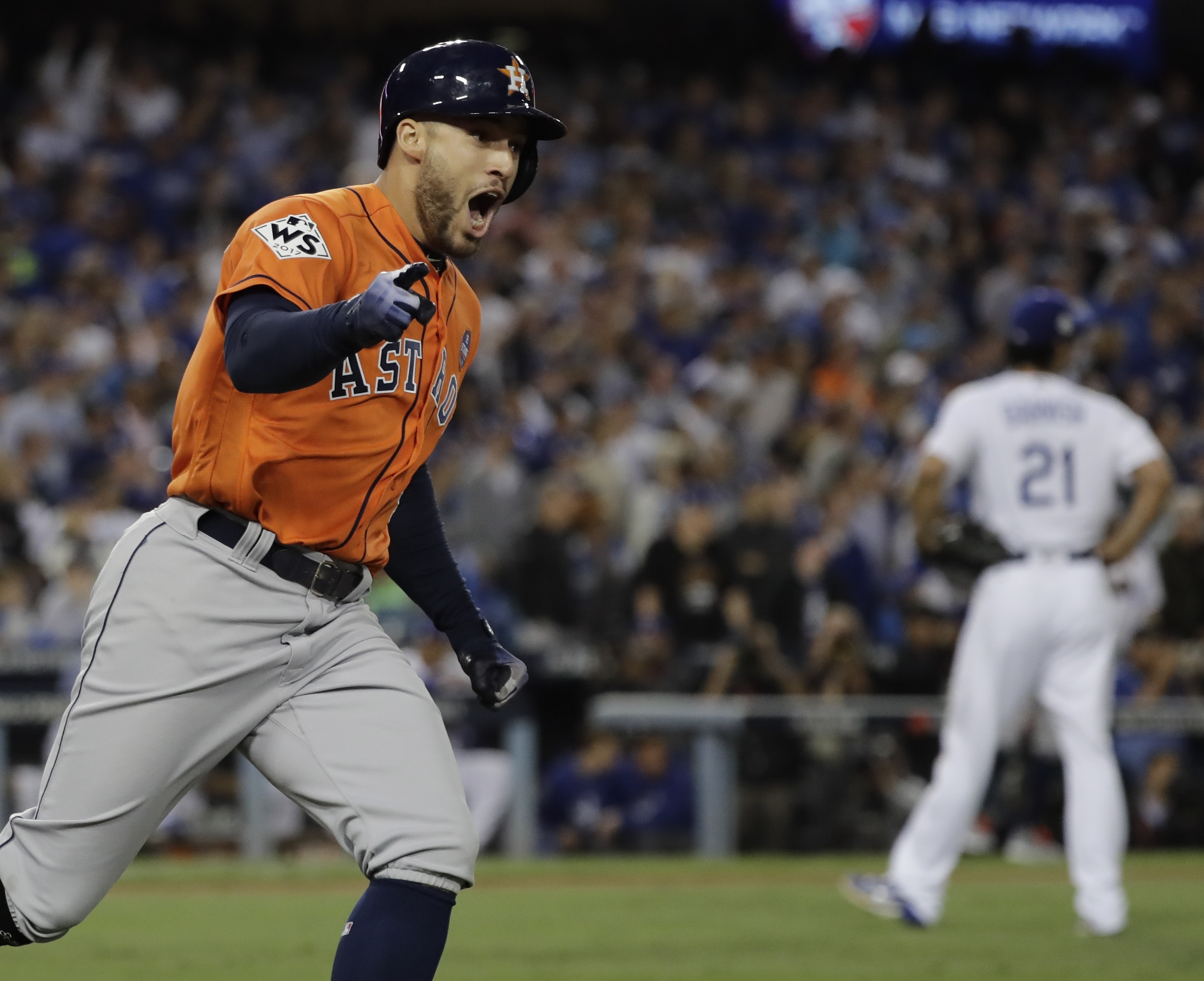 Houston Astros' George Springer reacts after hitting a two-run home run during the second inning of Game 7 of the World Series against the Los Angeles Dodgers Wednesday, Nov. 1, 2017, in Los Angeles. (AP Photo/David J. Phillip)