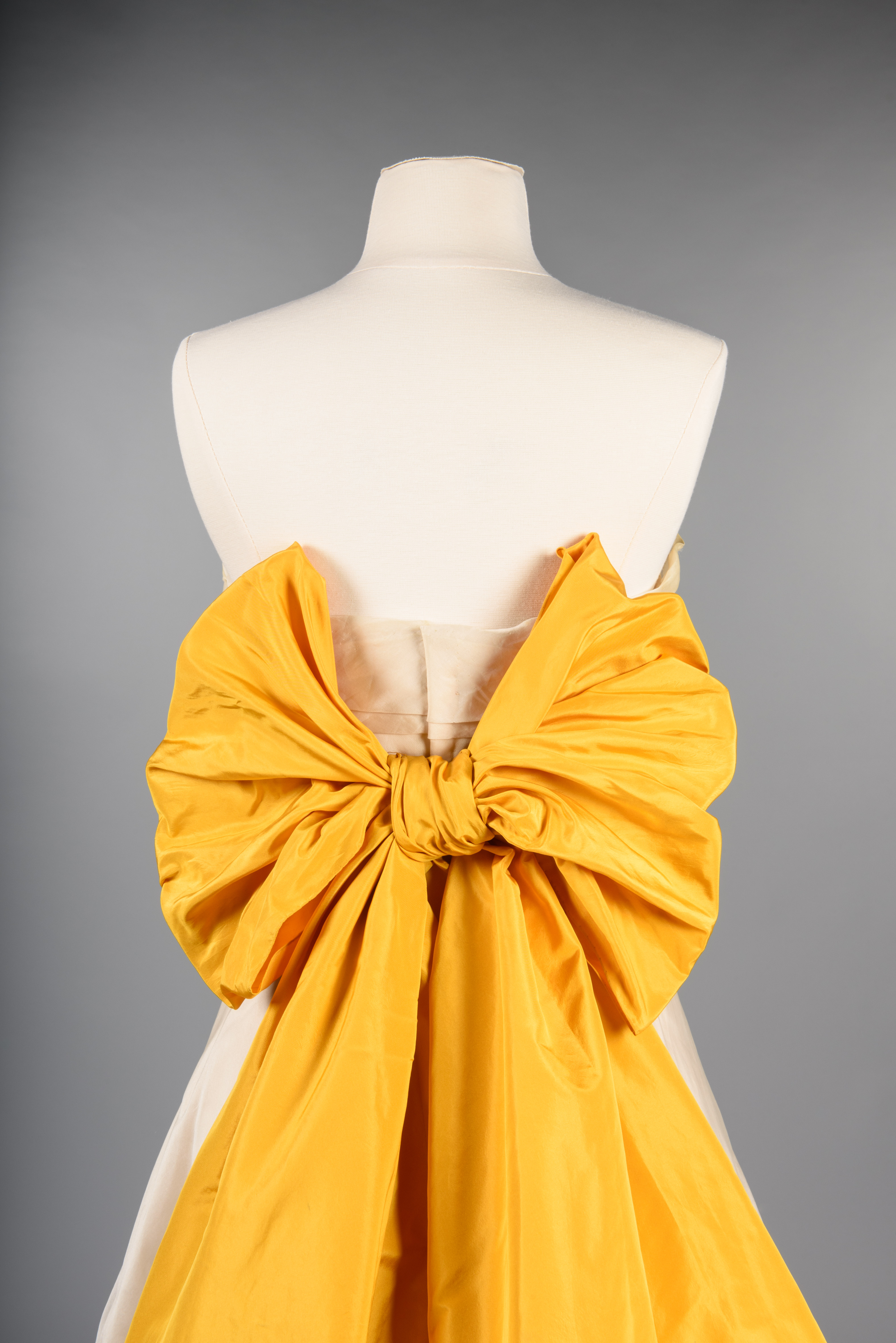 Evening gown with taffeta bow, about 1955, Irene, Los Angeles, maker Frederick & Nelson, retailer. Gift of Mrs. C. Winkler copyright MOHAI Collection.{ }