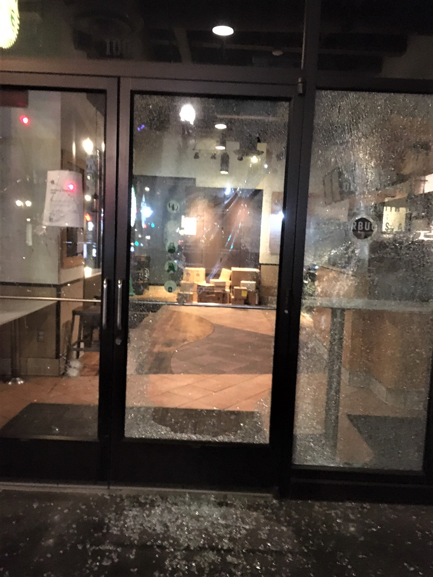 Windows of Starbucks Coffee broken during overnight protests in Portland on September 19, 2020 - Portland Police photo.