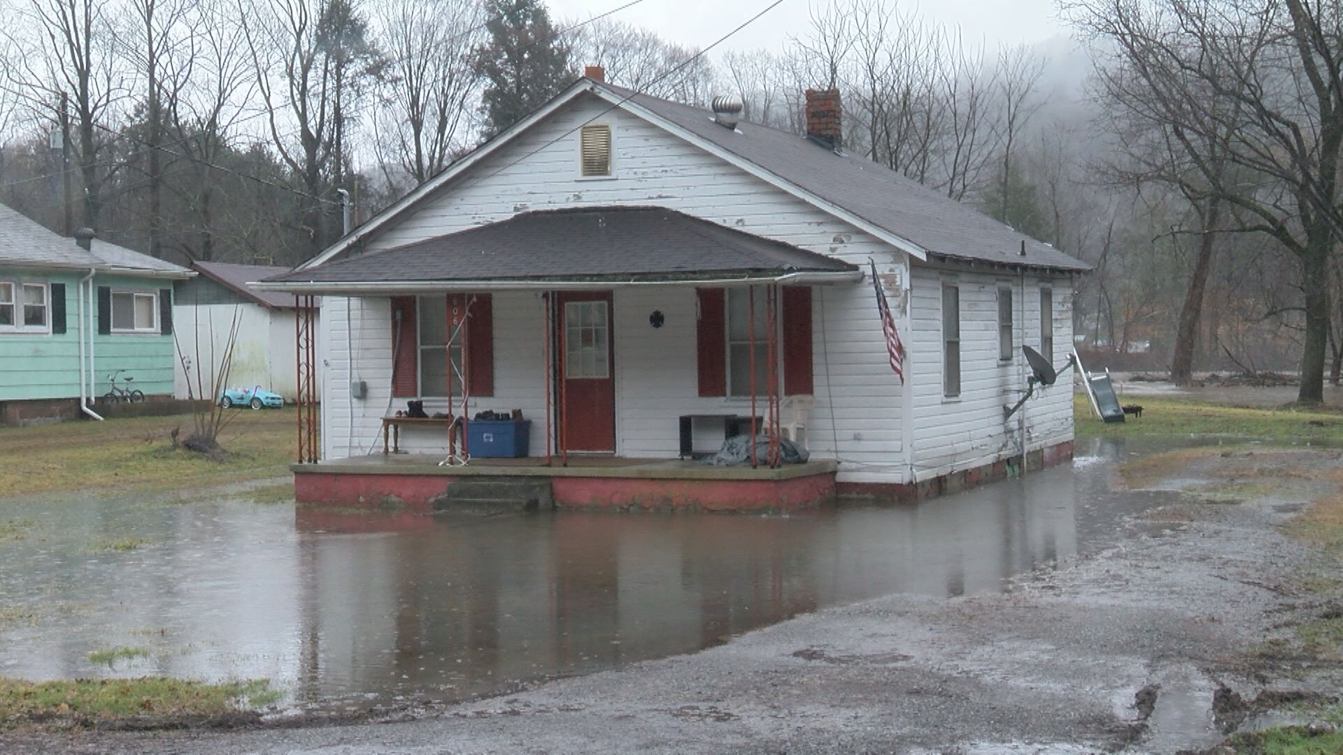 This is just one of several houses that were surrounded by water on Sunday.jpg
