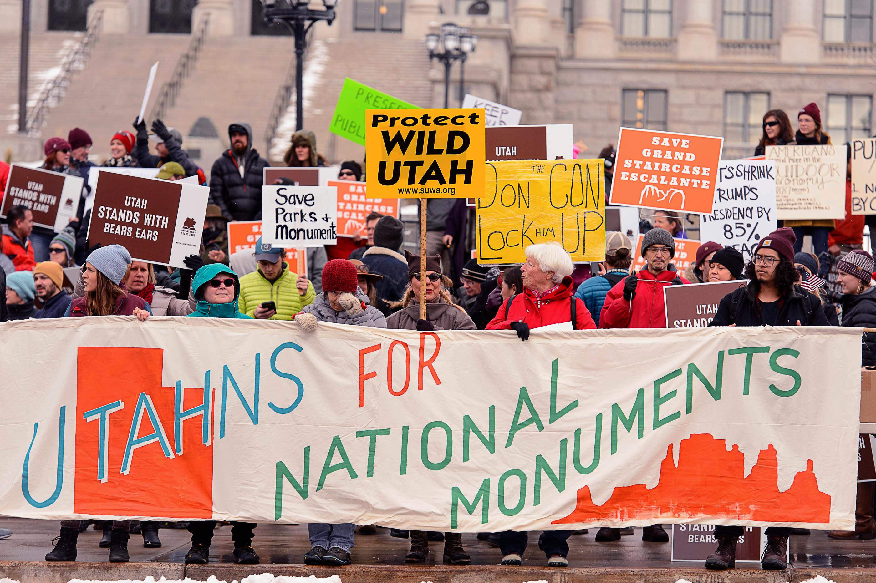 Protesters gather before a visit by President Donald Trump to announce that he is scaling back two sprawling national monuments, Monday Dec. 4, 2017, in Salt Lake City. (Trent Nelson/The Salt Lake Tribune via AP)