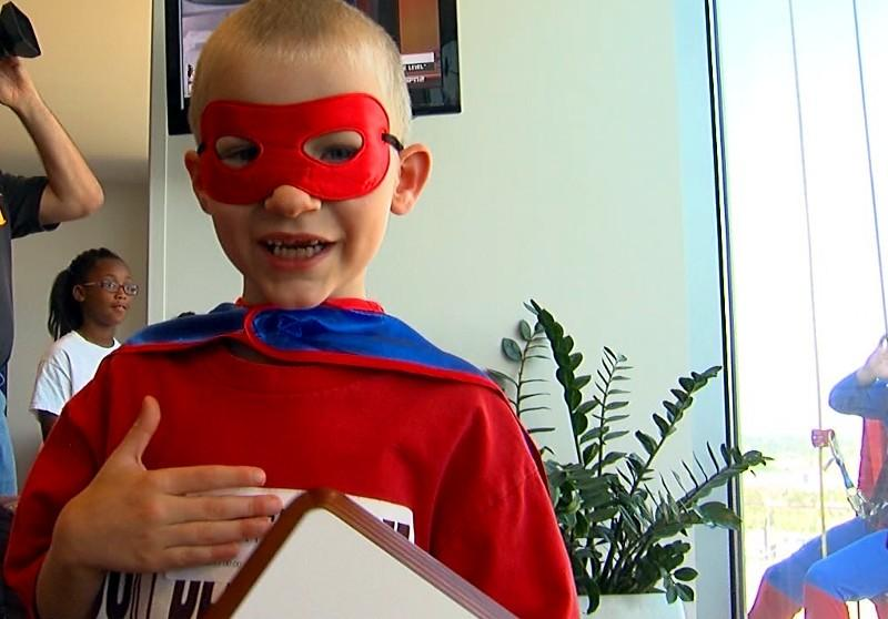 Superheroes squeegee windows at Children's of Alabama