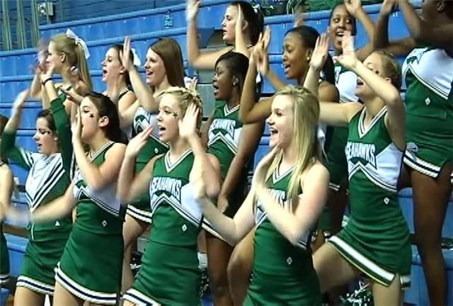 Myrtle Beach cheerleaders watch the Lady Seahawks beat Hartsville.