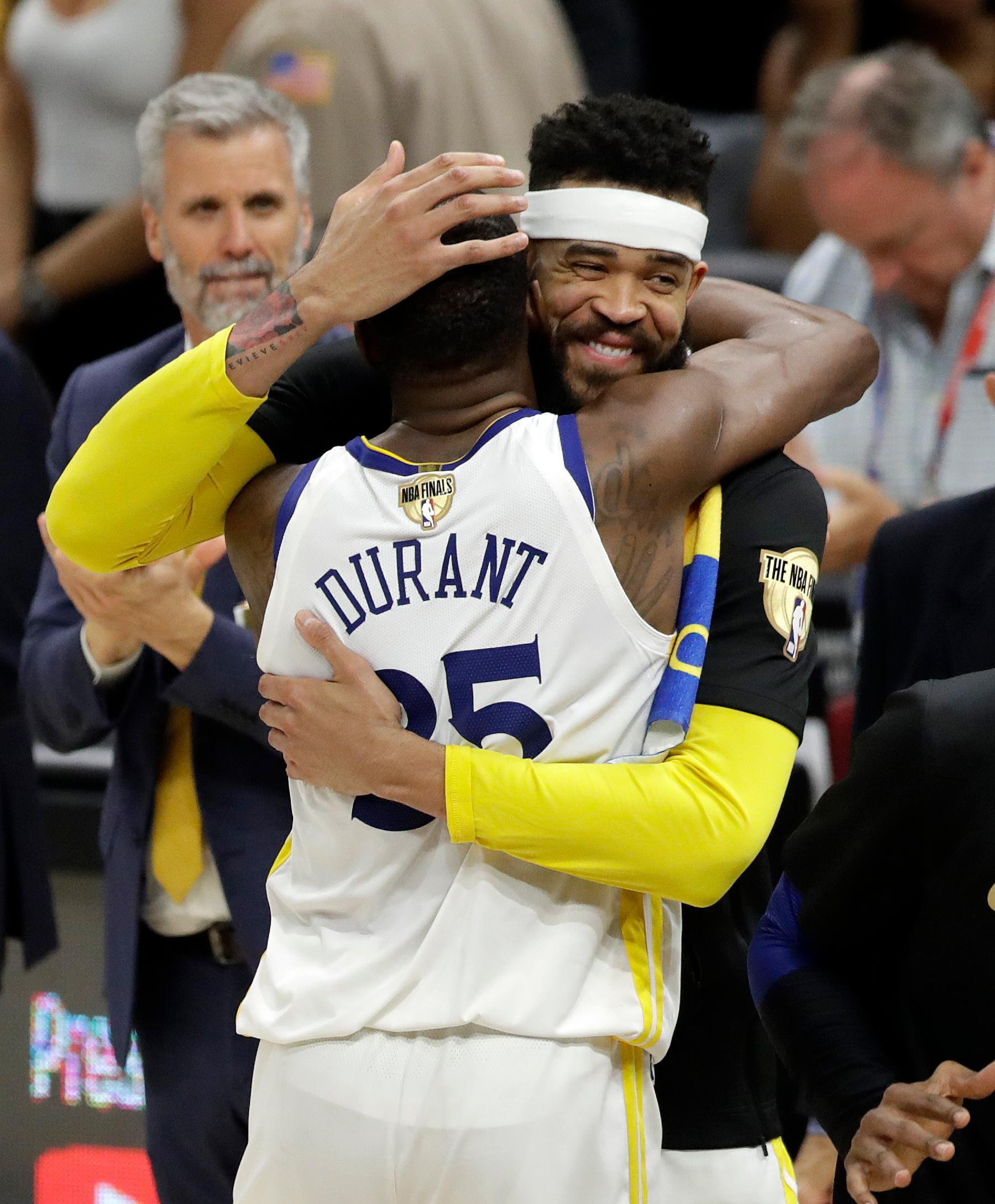 Golden State Warriors' Kevin Durant and JaVale McGee celebrate following Game 4 of basketball's NBA Finals against the Cleveland Cavaliers, Friday, June 8, 2018, in Cleveland. The Warriors defeated the Cavaliers 108-85. (AP Photo/Tony Dejak)