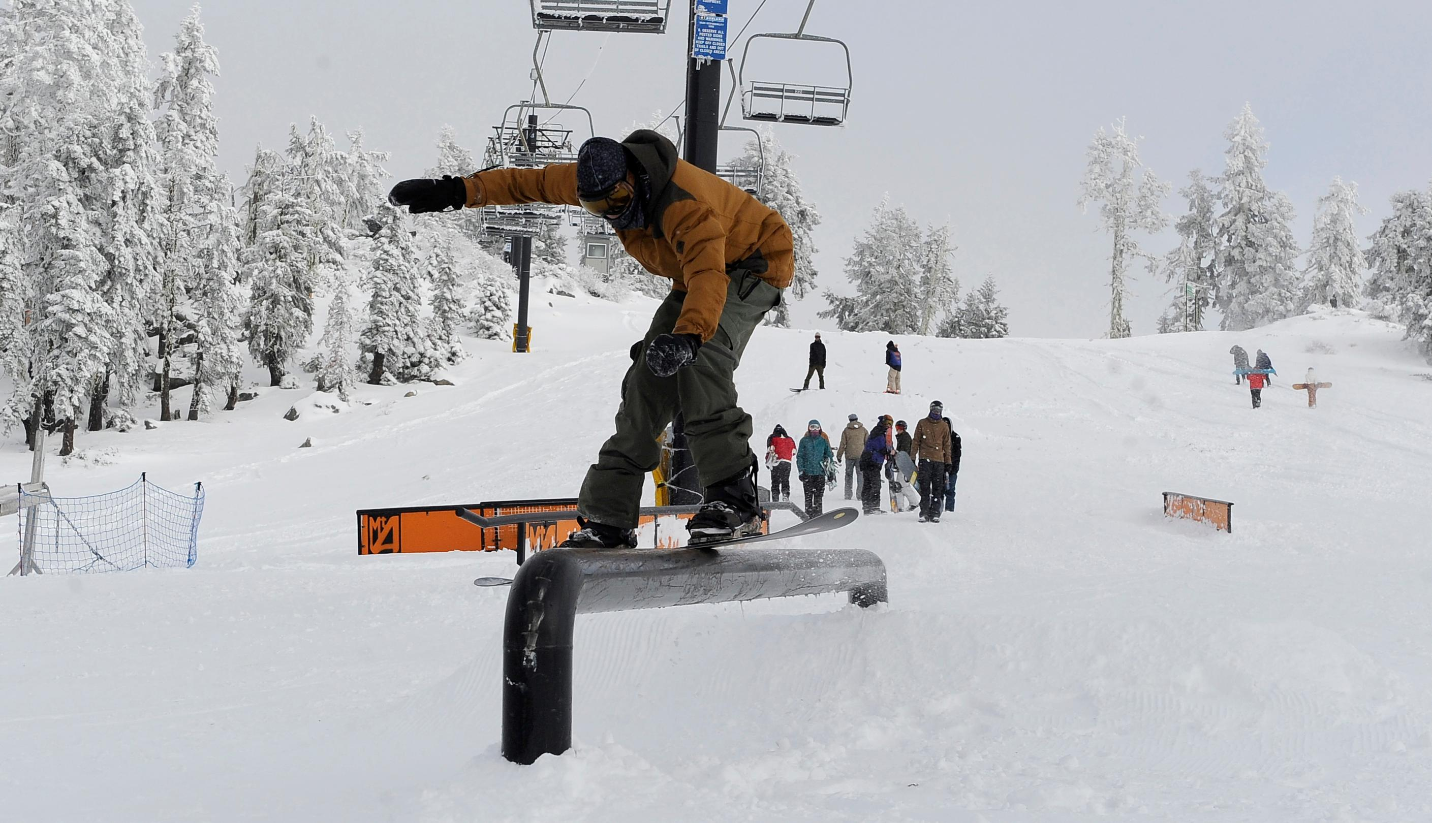 Andy Atkinson / Mail Tribune <br><p>A snowboarder rides a rail during Mt. Ashland's Snow Stomp Saturday afternoon.</p>