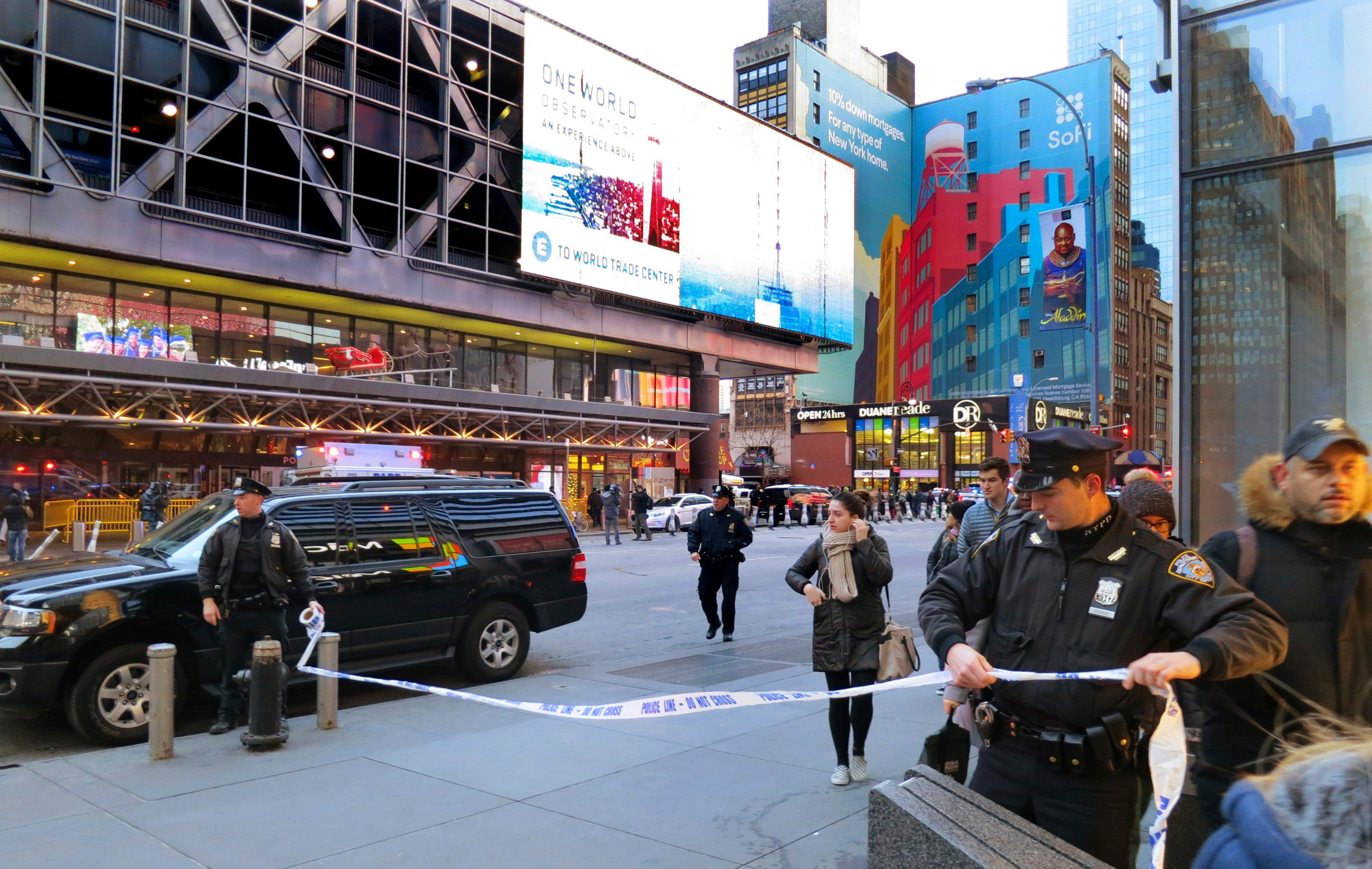 Police secure Eighth Avenue outside the Port Authority Bus Terminal following an explosion near New York's Times Square on Monday, Dec. 11, 2017. (AP Photo/Chuck Zoeller)<p></p>