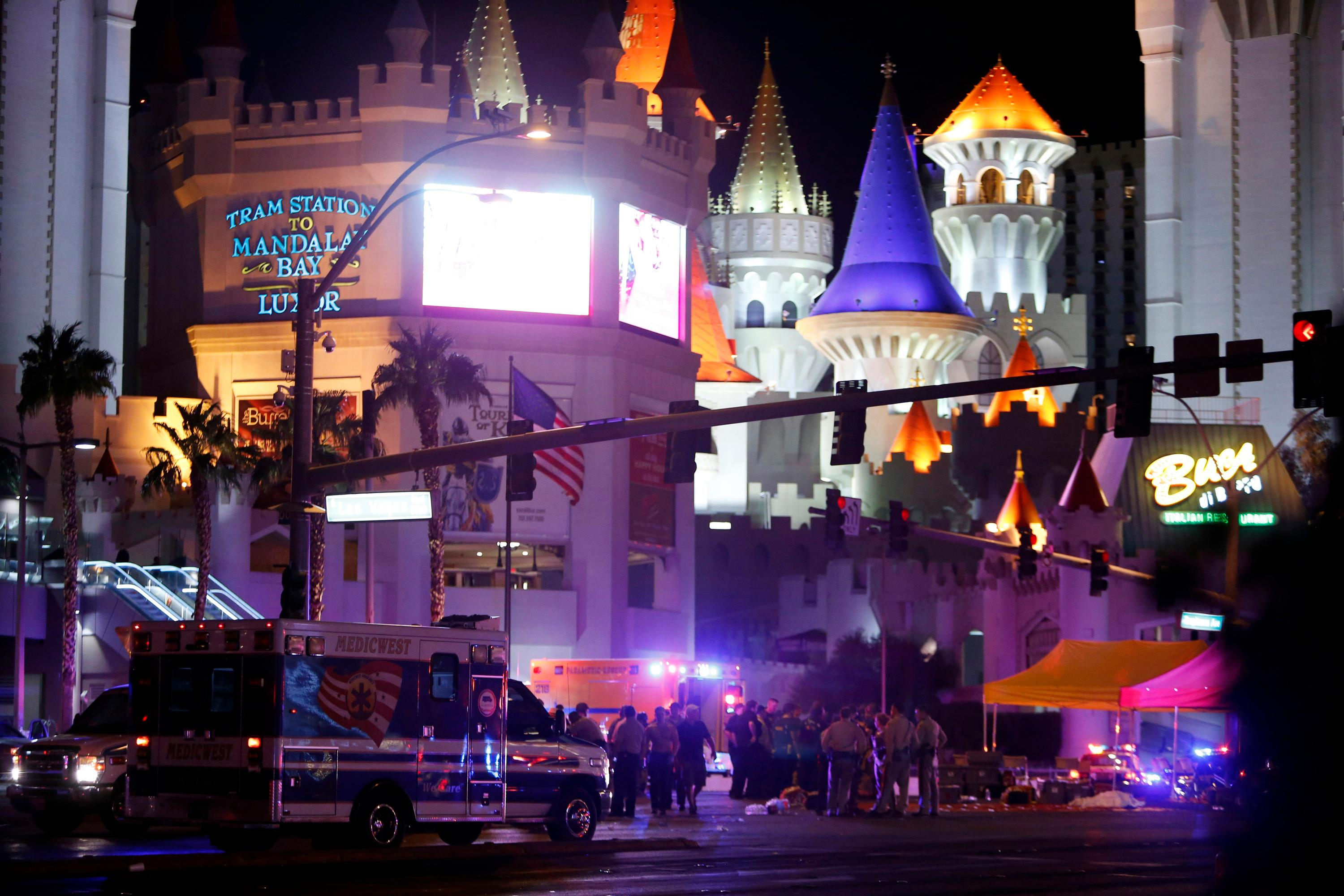 Las Vegas Metro Police and medical workers gather at an intersection after a mass shooting at a music festival on the Las Vegas Strip on Sunday, Oct. 1, 2017. (Steve Marcus/Las Vegas Sun via AP)