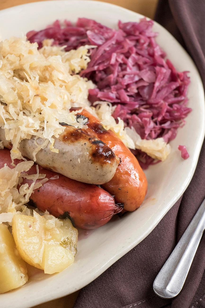 Wurst Platter with sweet and sour cabbage and German potato salad / Image: Allison McAdams // Published: 1.16.18<p></p>