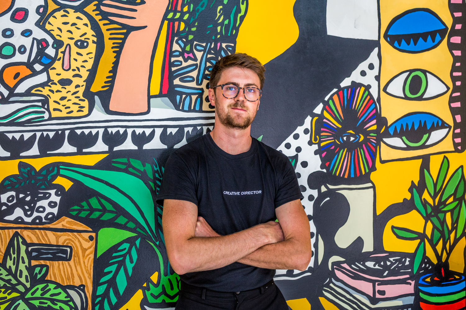 Cody Gunningham, creative director and artist behind the murals, paintings, and more /{ }Image: Catherine Viox{ }// Published: 9.19.19