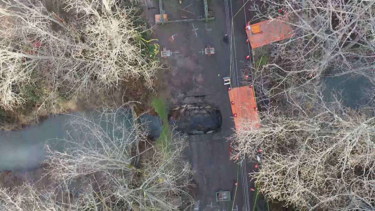 A sinkhole formed on Southeast Hideaway Court after the recent rainstorm caused an old pipe to fail in Damascus. (Clackamas County)