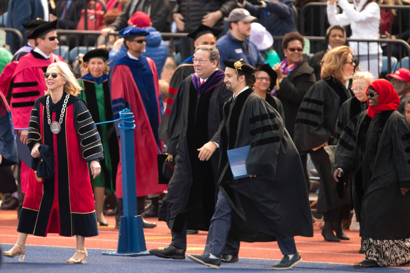 "Lin-Manuel Miranda, front right, creator of the Broadway musical ""Hamilton,"" walks with faculty during the University of Pennsylvania commencement ceremony, Monday, May 16, 2016, in Philadelphia. (AP Photo/Matt Rourke)"