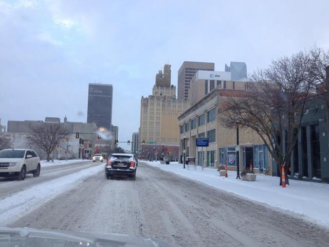 Snow covered Broadway Ave going into downtown. FOX 25's Danielle Dupuy says it's very slick when trying to turn.