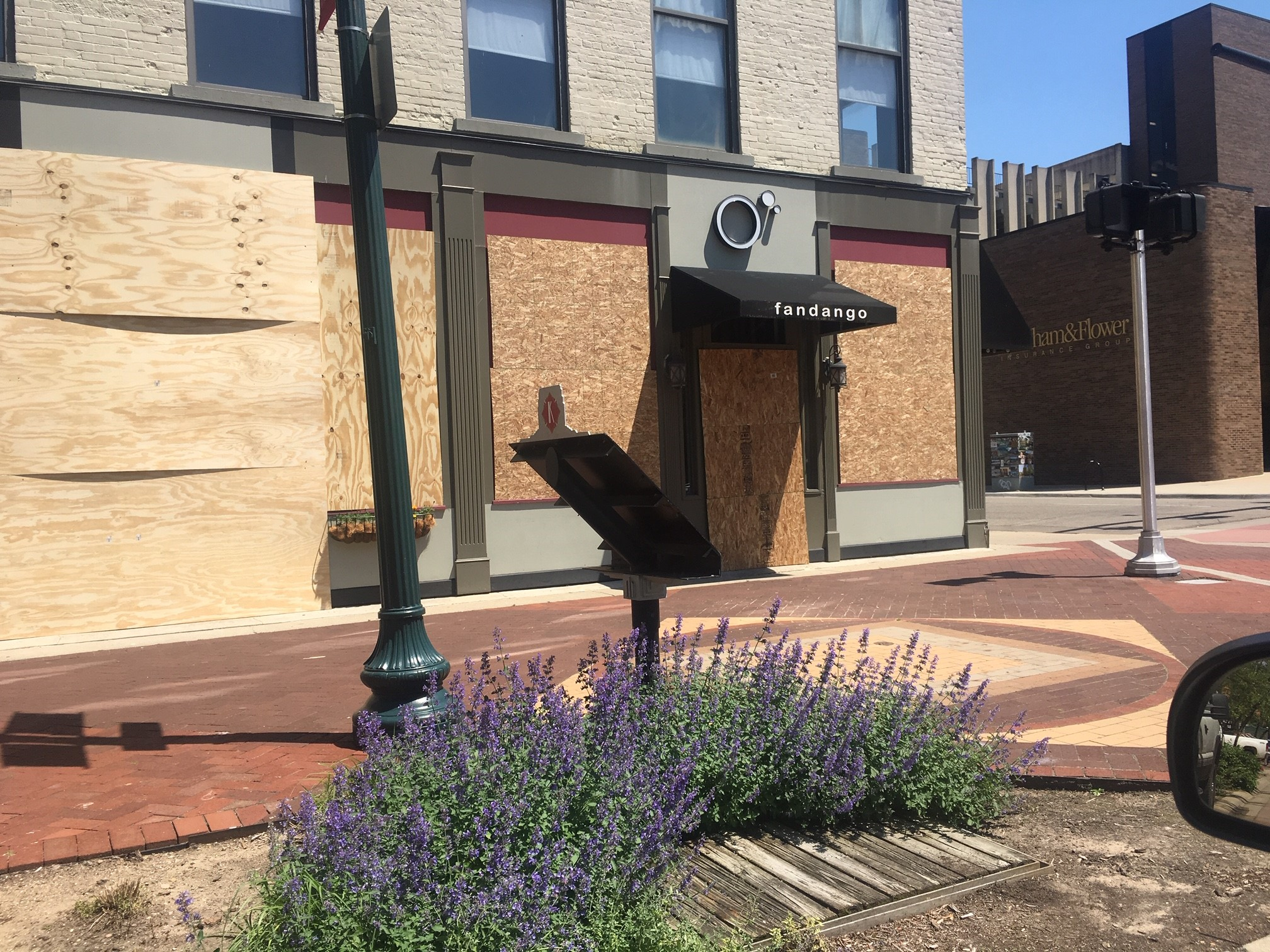 Fandango Tapas Bistro is among  the businesses on the Kalamazoo Mall that boarded up Tuesday, June 2, 2020, as the city expected another night of violent protests. City officials set a 7 p.m. curfew for Tuesday night and into Wednesday morning. (WWMT/Mike Krafcik)