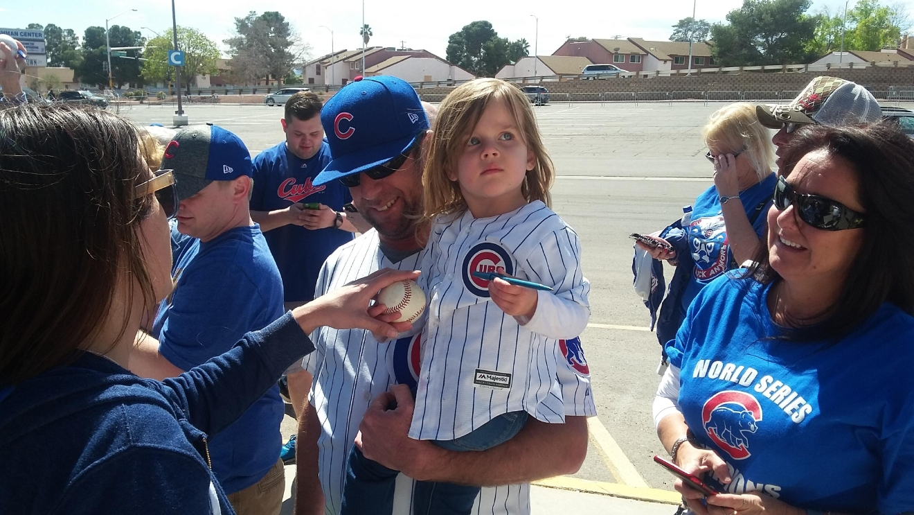 A young fan awaits to meet Kris Bryant on Saturday, March 25, 2017, during Big League Weekend between the Chicago Cubs and Cincinnati Reds at Cashman Field in Las Vegas. (Tony Garcia/KSNV)