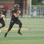 Sidney sinks Carroll 35-7 despite injury to QB Gordon