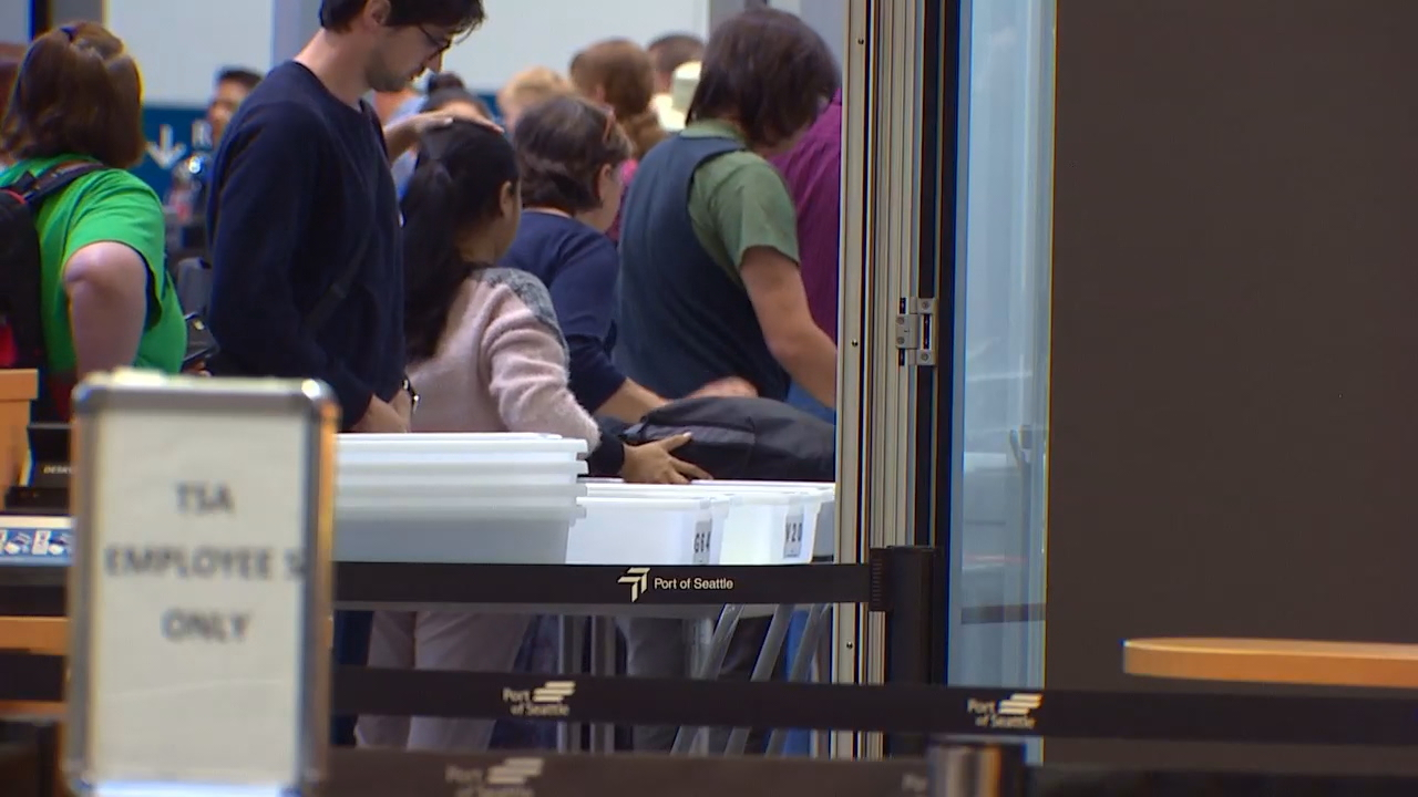 At about ten airports around the country, the Transportation Security Administration is requiring passengers to put electronics larger than a cellphone - as well as other items - into separate bins for X-ray screening. (Photo: KOMO News)