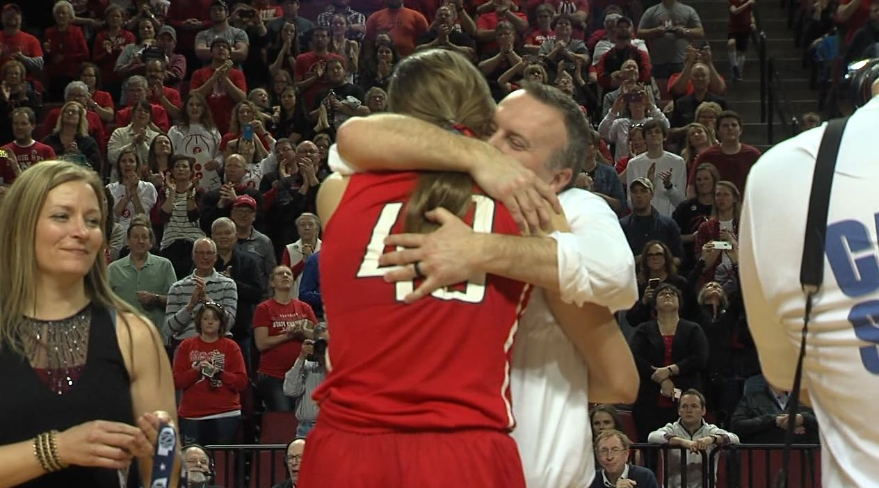 Meyer hugs head coach Jim Sullivan after being awarded her medal in PBA.{&amp;nbsp;}<p></p>