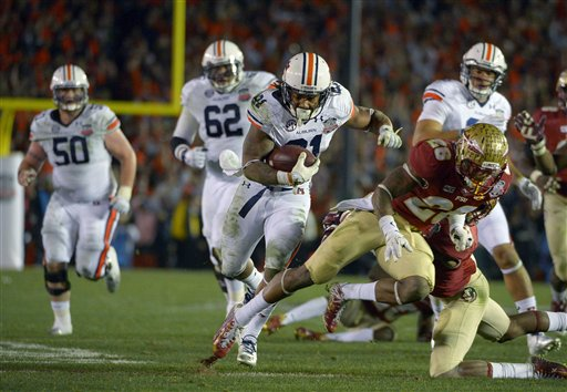 Auburn's Tre Mason breaks away for a touchdown during the second half of the NCAA BCS National Championship college football game against Florida State Monday, Jan. 6, 2014, in Pasadena, Calif.