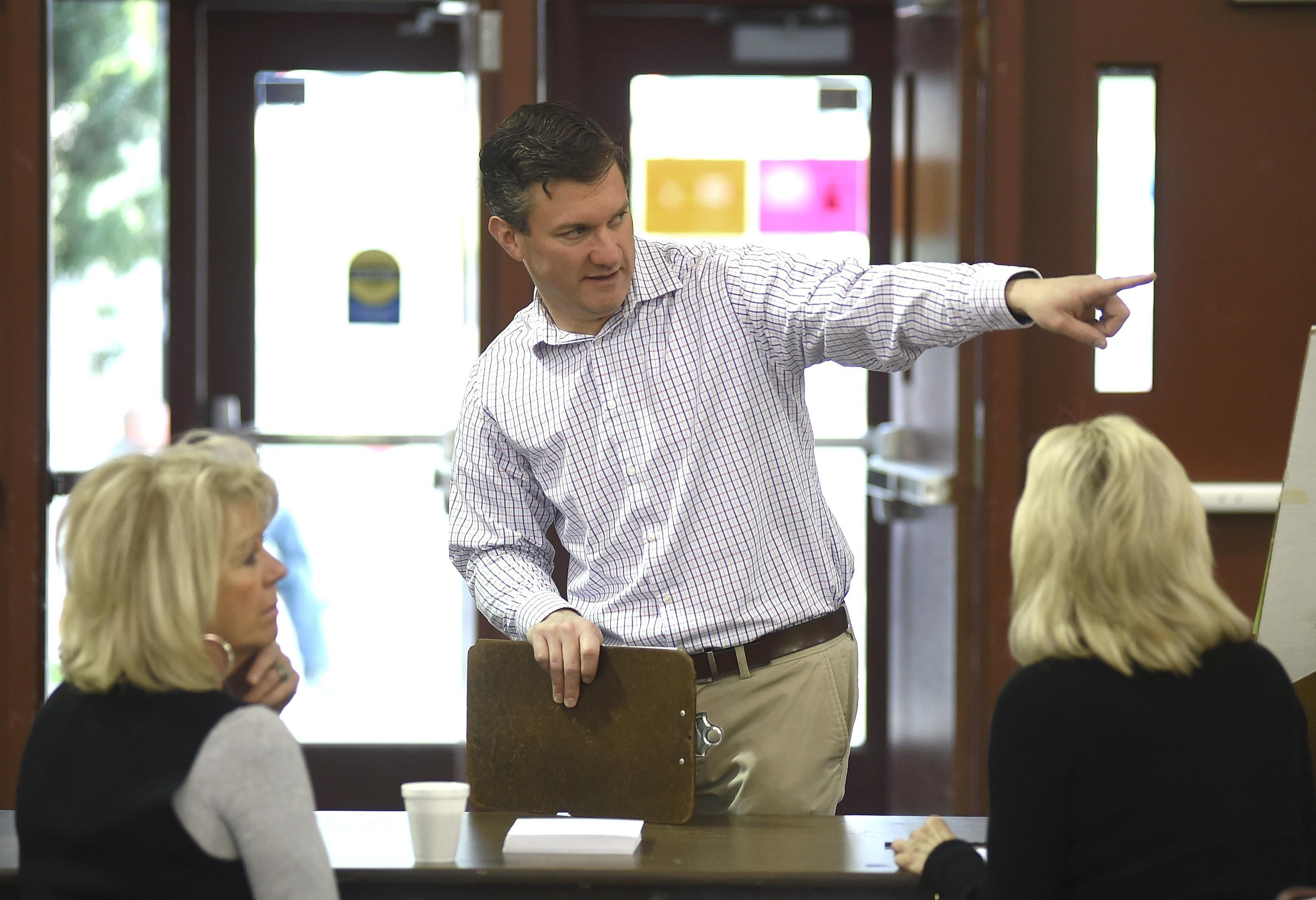 Yellowstone County Election Administrator Bret Rutherford briefs election staff at MetraPark in Billings, Mont., Thursday, May 25, 2017. (Larry Mayer /The Billings Gazette via AP)