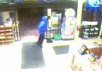 Surveillance image of an armed robbery at Grand Central Station in Bellevue, May 13, 2014. (Brown Co. Sheriff's Office)
