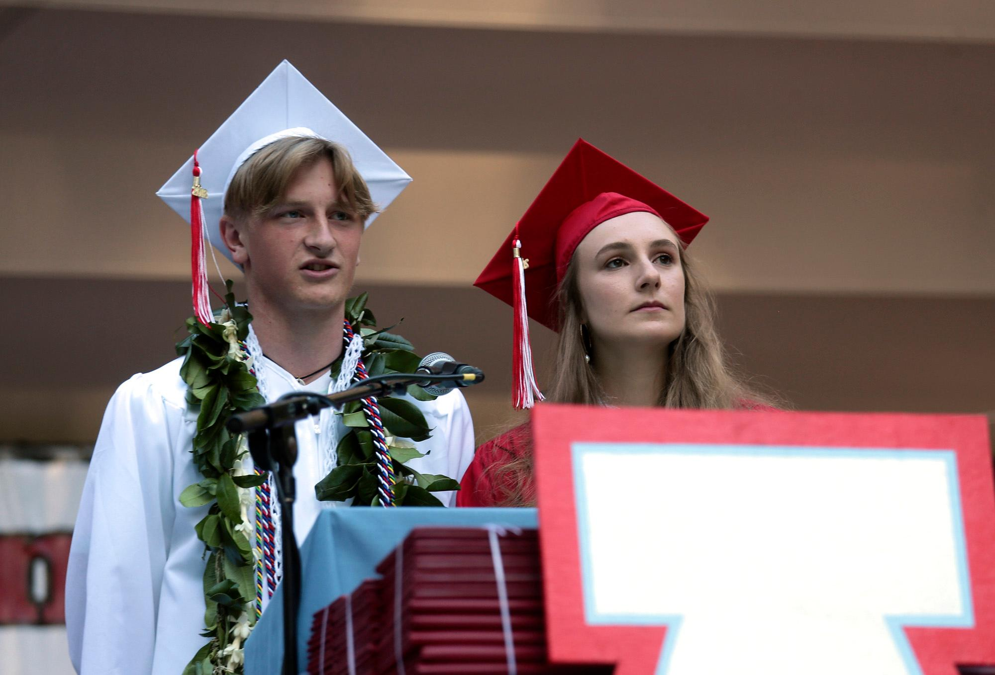 ASB Co-Presidents Ellie Carter and Kip Parowski speaking at Ashland High's Class of 2018 Commencement Ceremony at Lithia Park.   [ / PHOTO BY:  LARRY STAUTH JR]