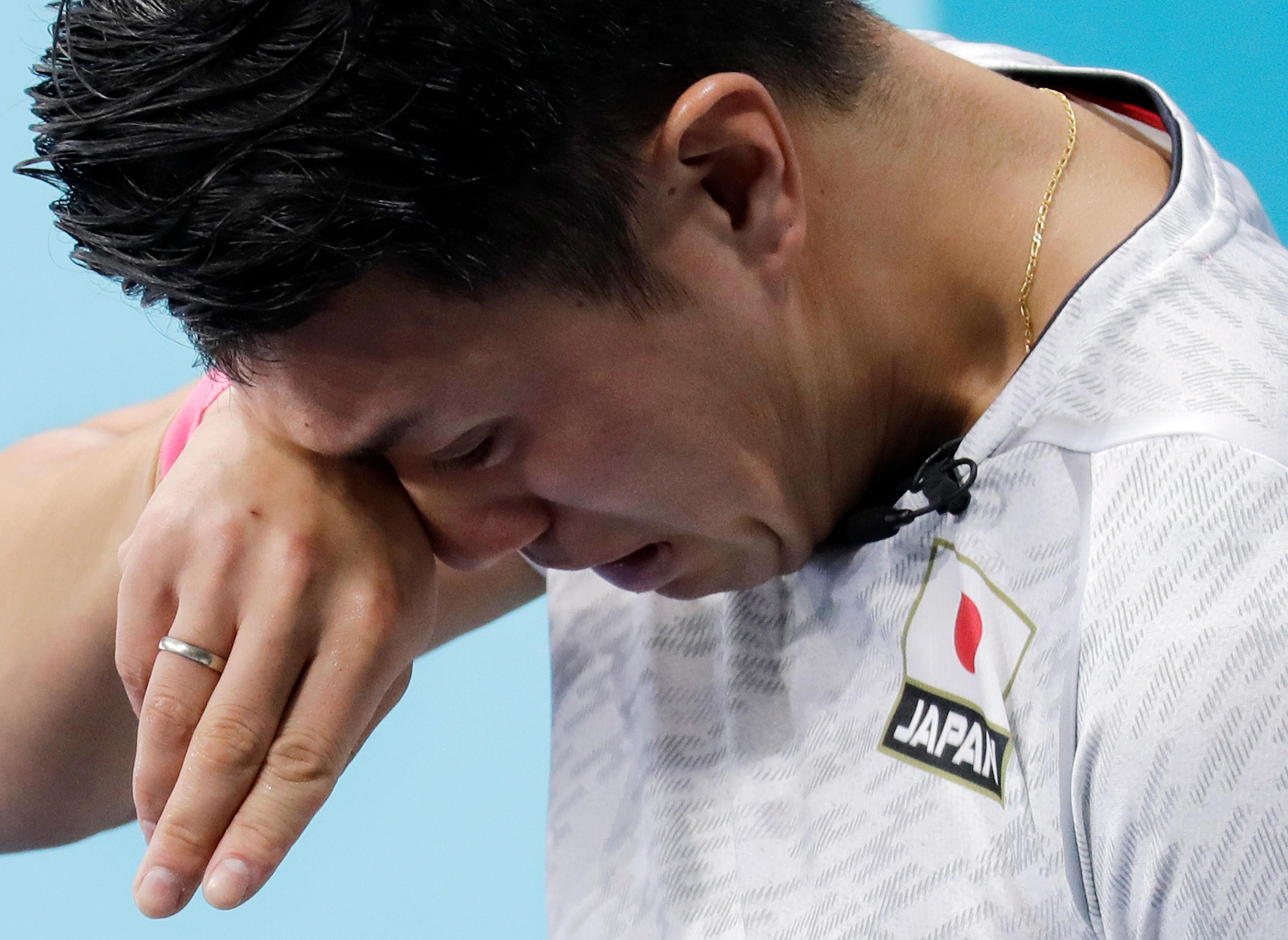 Japan's Tsuyoshi Yamaguchi cries after they lost their match against South Korea during the men's curling match at the 2018 Winter Olympics in Gangneung, South Korea, Wednesday, Feb. 21, 2018. (AP Photo/Aaron Favila)
