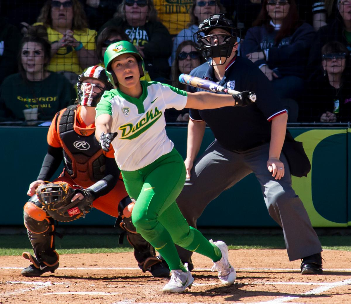Oregon center fielder Shannon Rhodes (#9) watches her home run ball fly over the perimeter fence. The Oregon Ducks defeated the Oregon State Beavers seven to zero on Sunday, April 30, 2017. The Ducks' victory marked the third victory of the three game sweep against the Beavers. Photo by Ben Lonergan, Oregon News Lab