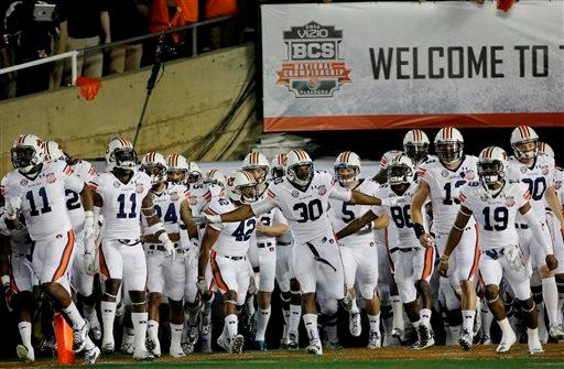 Auburn runs onto the field before the NCAA BCS National Championship college football game against Florida State Monday, Jan. 6, 2014, in Pasadena, Calif.