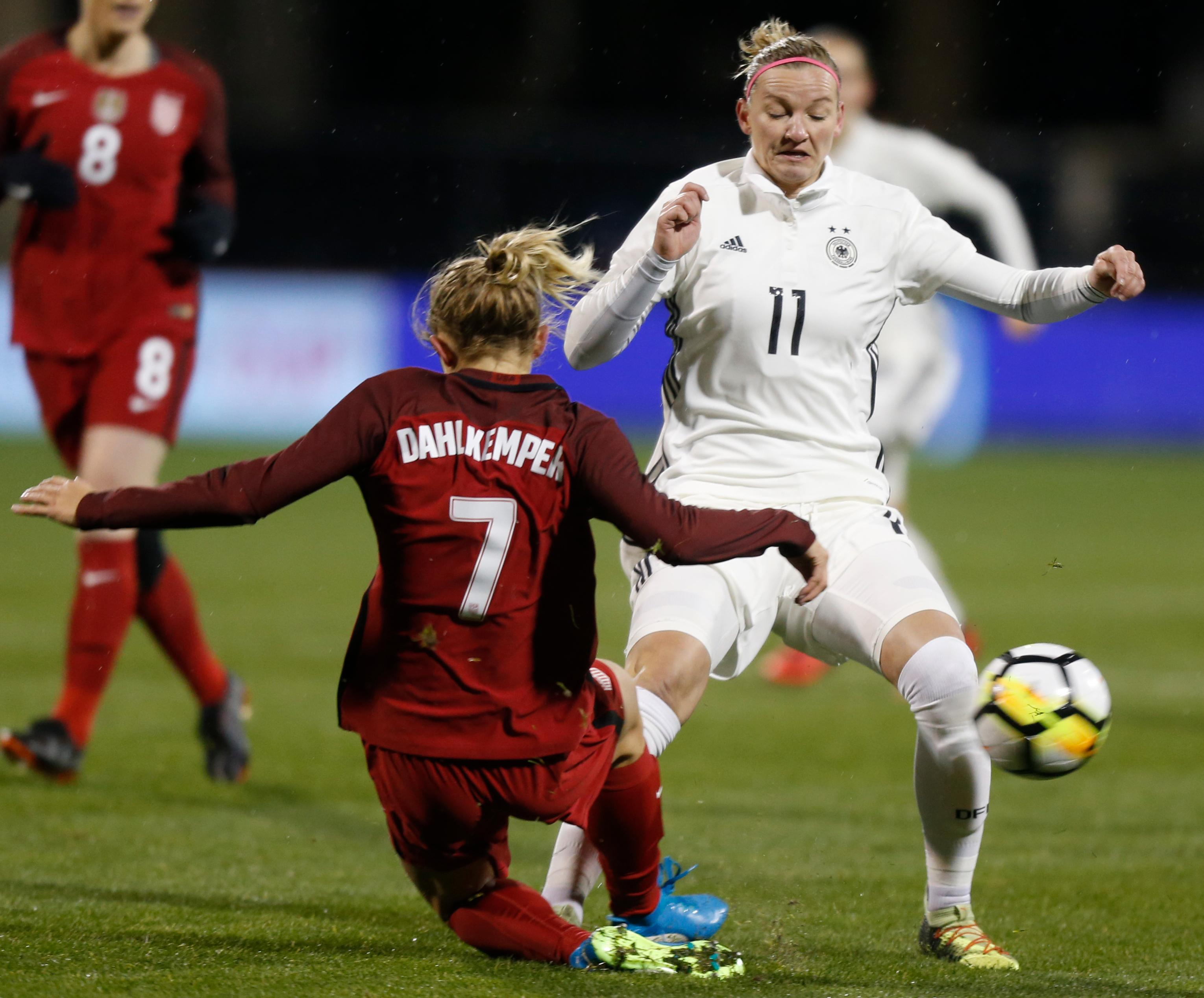 Germany's Alexandra Popp, right, kicks the ball away from United States' Abby Dahlkemper during the first half of a SheBelieves Cup women's soccer match Thursday, March 1, 2018, in Columbus, Ohio. (AP Photo/Jay LaPrete)
