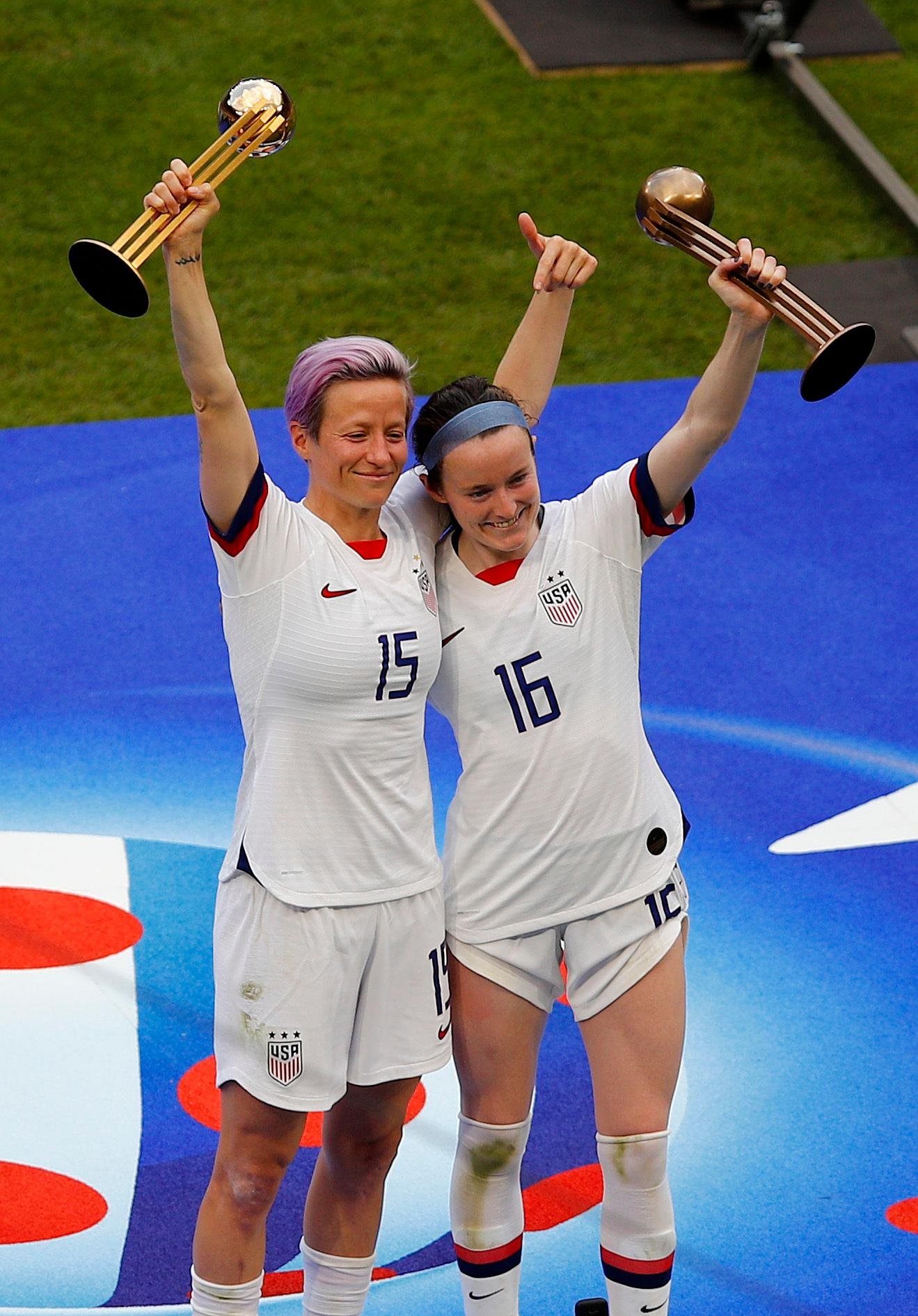 United States' Megan Rapinoe , left, and United States' Rose Lavelle celebrate after their team won the Women's World Cup final soccer match between US and The Netherlands at the Stade de Lyon in Decines, outside Lyon, France, Sunday, July 7, 2019. (AP Photo/Francois Mori)