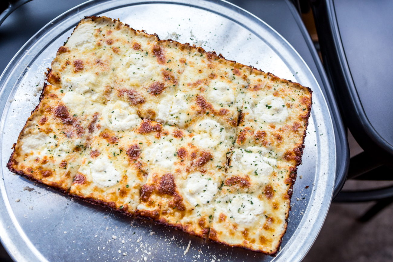 Detroit-style Bianca Pizza: evoo, garlic, parsley, ricotta, parmigiano reggiano, and mozzarella / Image: Catherine Viox{ }// Published: 7.12.19
