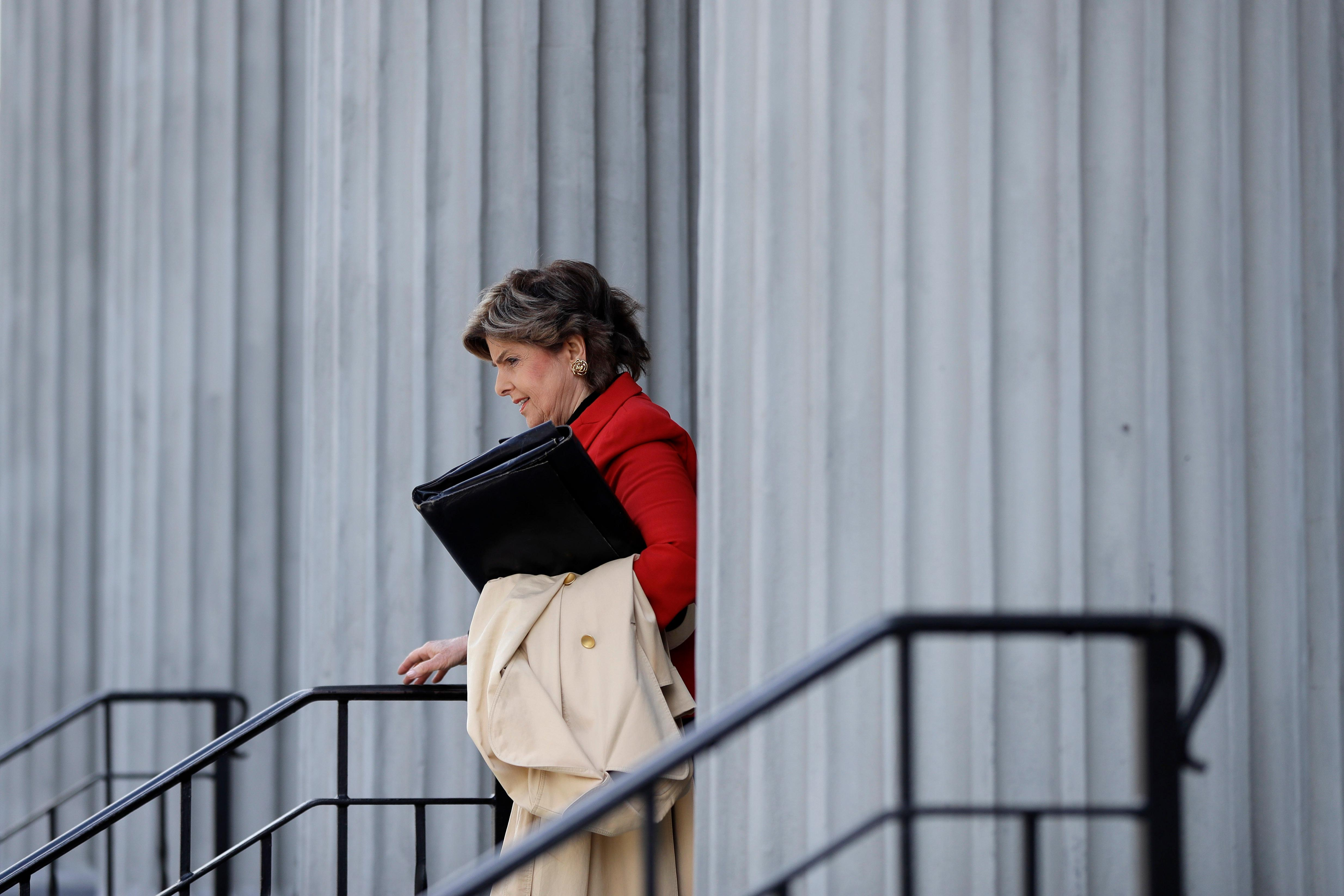 Attorney Gloria Allred walks outside the Montgomery County Courthouse during a break in Bill Cosby's sexual assault retrial, Monday, April 16, 2018, in Norristown, Pa. (AP Photo/Matt Slocum)