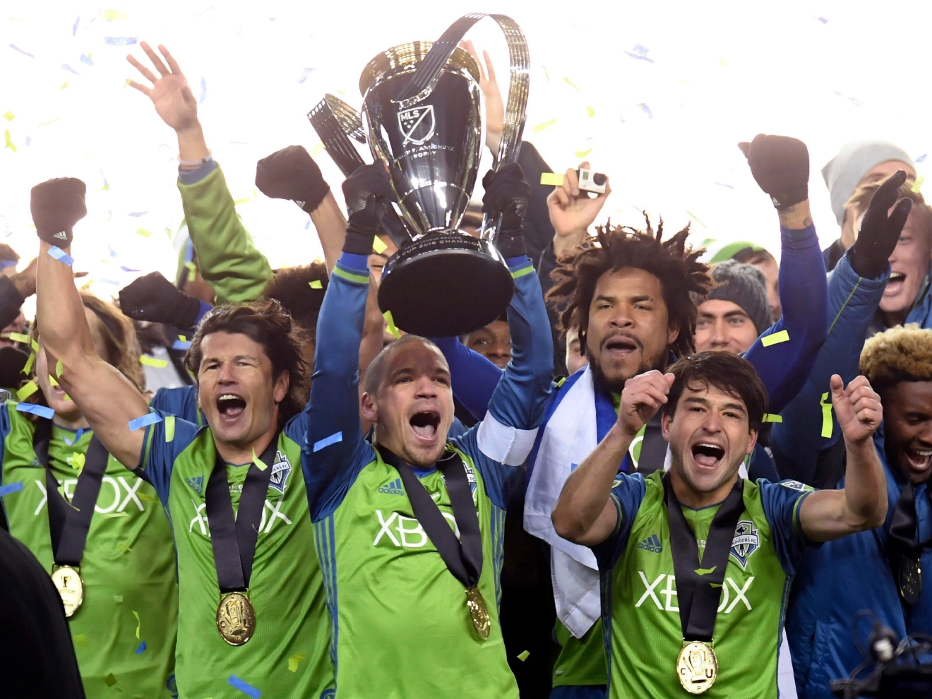 Members of the Seattle Sounders celebrate after winning the MLS Cup soccer final over Toronto FC in Toronto, Saturday, Dec. 10, 2016. Frank Gunn/The Canadian Press via AP)