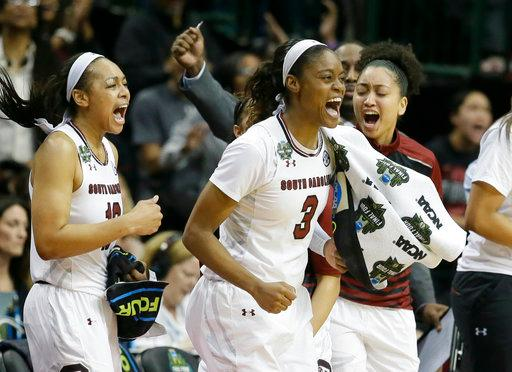 South Carolina guard Allisha Gray (10), guard Kaela Davis (3) and teammates celebrate during the second half of an NCAA college basketball game against the Stanford in the semifinals of the women's Final Four, Friday, March 31, 2017, Friday, March 31, 2017, in Dallas. (AP Photo/LM Otero)