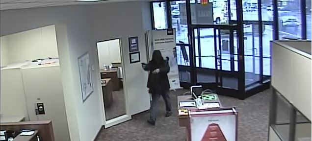 Photo from surveillance video shows a man point a gun at the BB&T Branch in Kanawha City at 38th Street and MacCorkle Avenue. (Charleston Police Department)