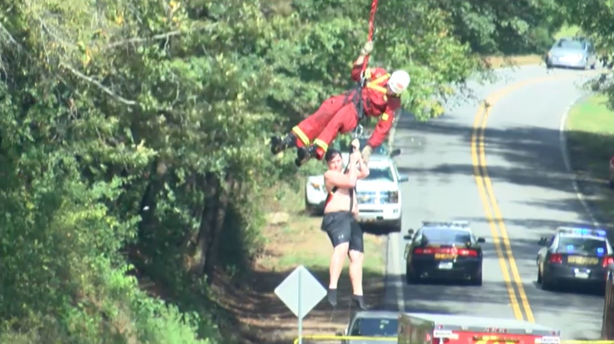 A teen was rescued by helicopter Tuesday afternoon after he and his younger brother were swept over a waterfall at High Falls State Park. The younger child did not make it.  / Danielle Apolinar (WGXA)