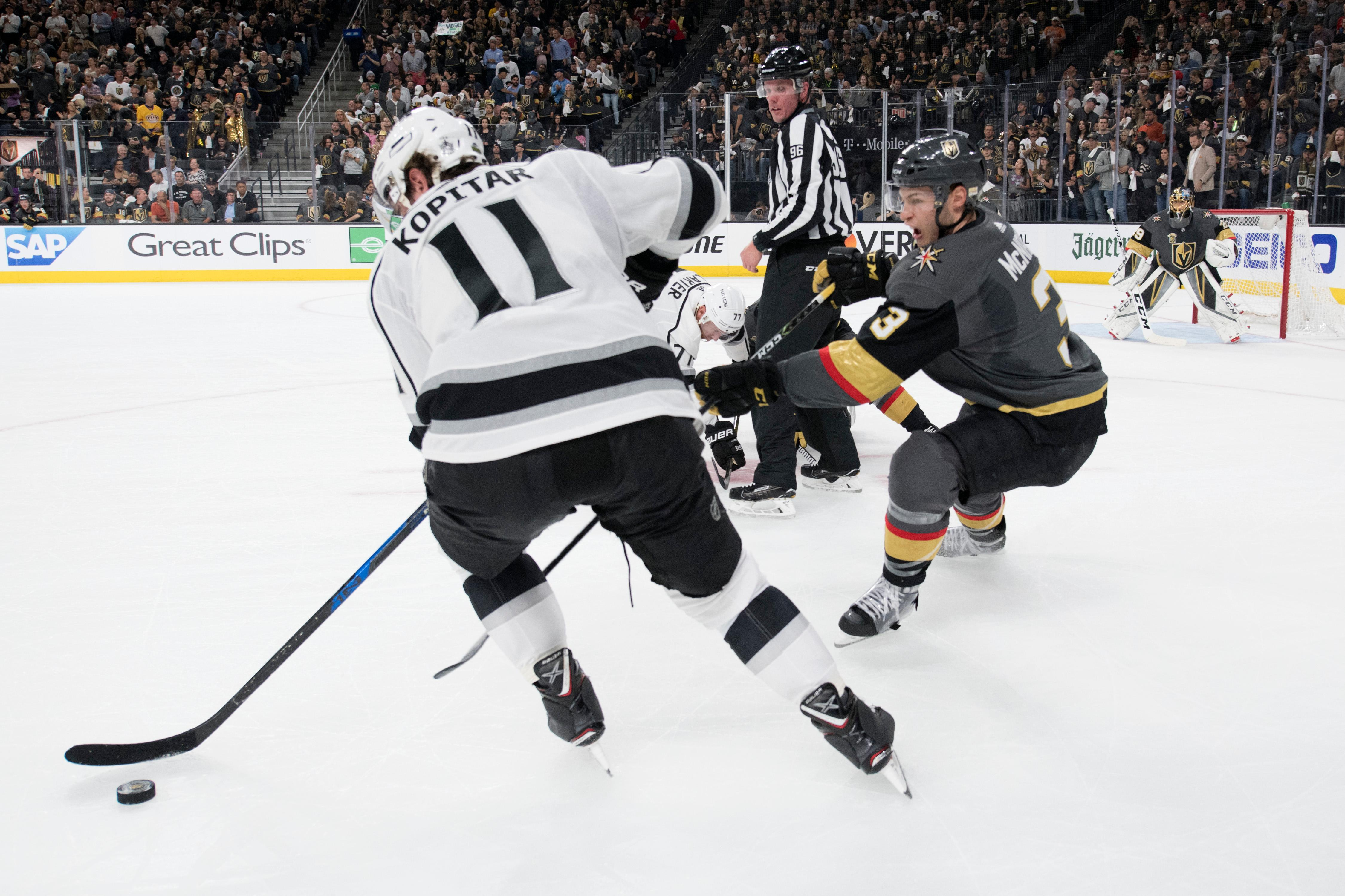 Los Angeles Kings center Anze Kopitar (11) and Vegas Golden Knights defenseman Brayden McNabb (3) chase down the puck during the first period of Game 1 of their NHL hockey first-round playoff series Wednesday, April 11, 2018 at T-Mobile Arena. The Knights won 1-0. CREDIT: Sam Morris/Las Vegas News Bureau
