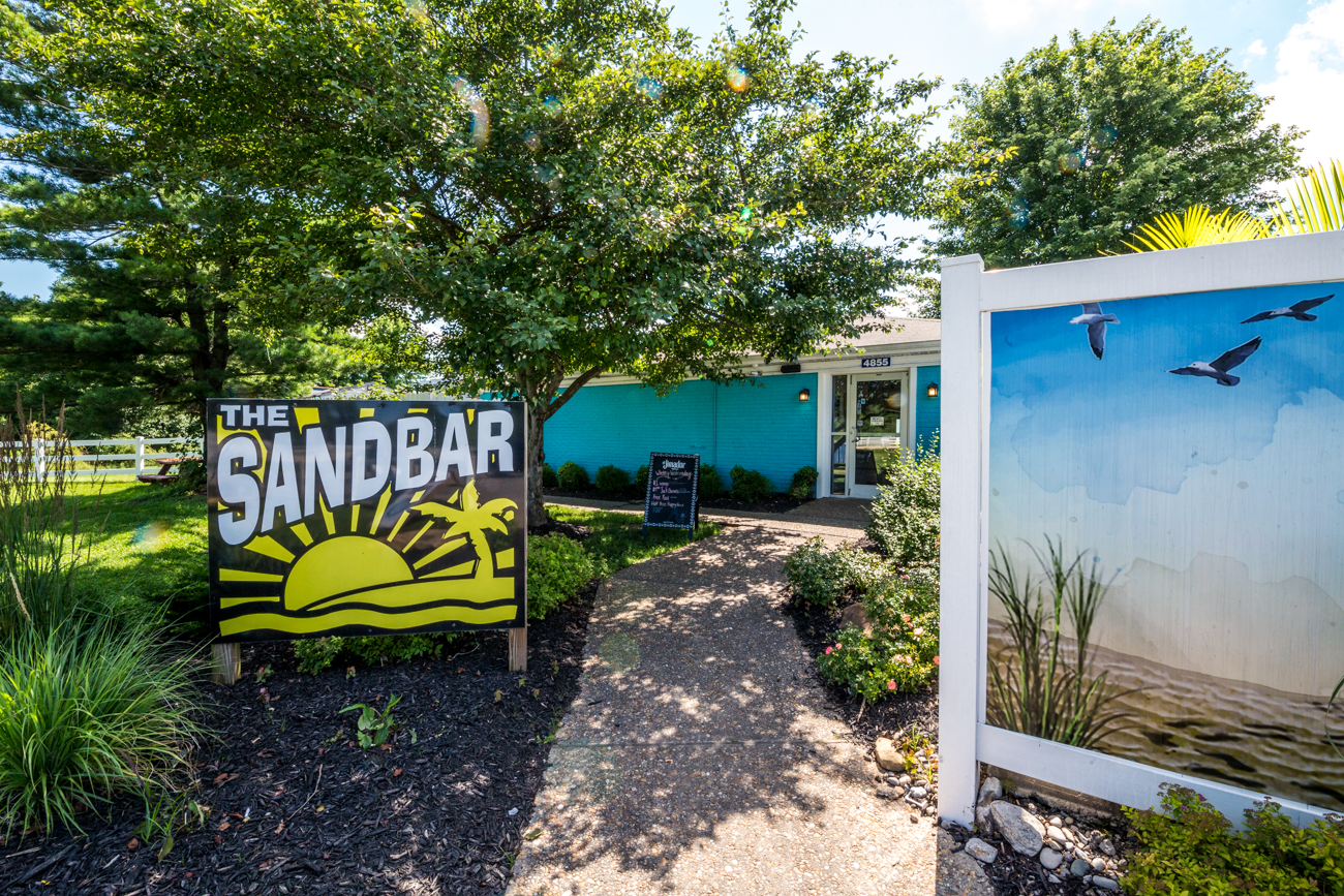 PLACE: The Sandbar / ADDRESS: 4855 Kellogg Avenue (East End) / The Sandbar is an outdoor cabana bar in the Four Seasons Marina. It has an indoor bar and restaurant along with seven sand volleyball courts to challenge friends and foes while overlooking the hundreds of boats in the marina. Live bands perform on the weekends. / Image: Catherine Viox // Published: 7.18.19