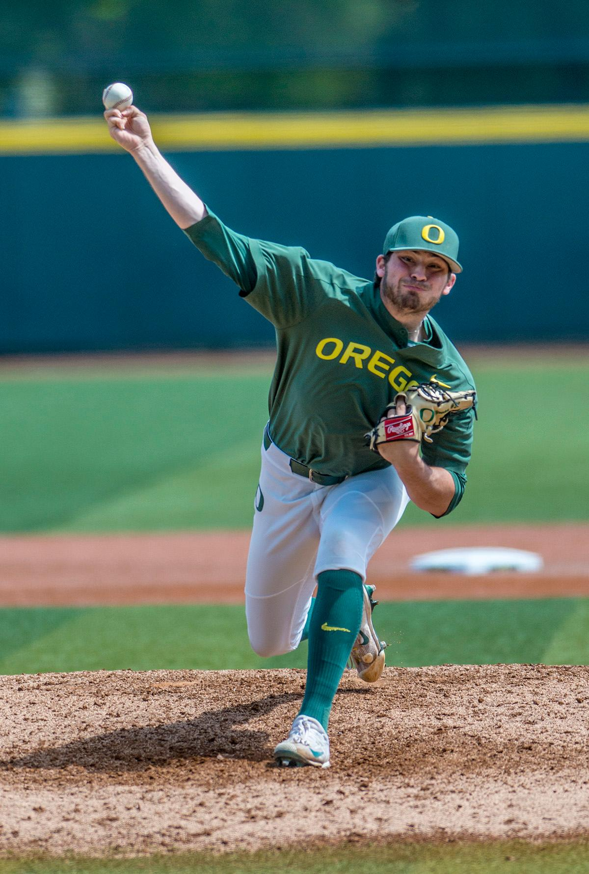 Oregon Ducks right-handed pitcher Kenyon Yovan (#21) throws from the mound. The Oregon Ducks defeated the Arizona State Sun Devils 3-2 on Sunday in the final game of the three-game series to close out with two wins and one loss. Jacob Bennett (#16) gave the Ducks their first point in the third inning. Kyle Kasser (#9) and Morgan McCullough (#1) added two more points in the fourth inning to give the Oregon Ducks enough of a lead to hold off the Sun Devils to the end of the ninth. The Oregon Ducks will play the Oregon State Beavers next in Corvallis, Ore, on May 2 at 5:30 p.m. Photo by Rhianna Gelhart, Oregon News Lab