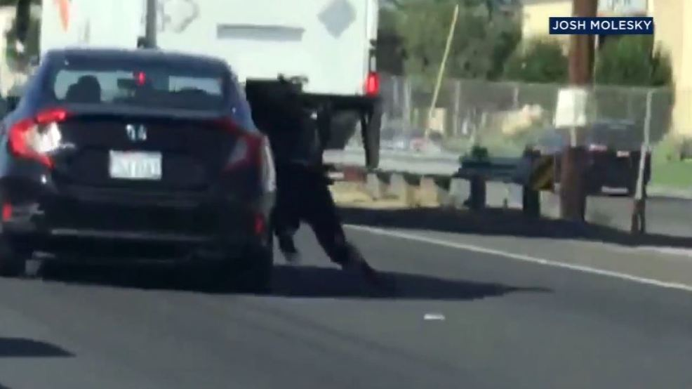 Video Shows Woman Clinging To Car On California Freeway Wsyx