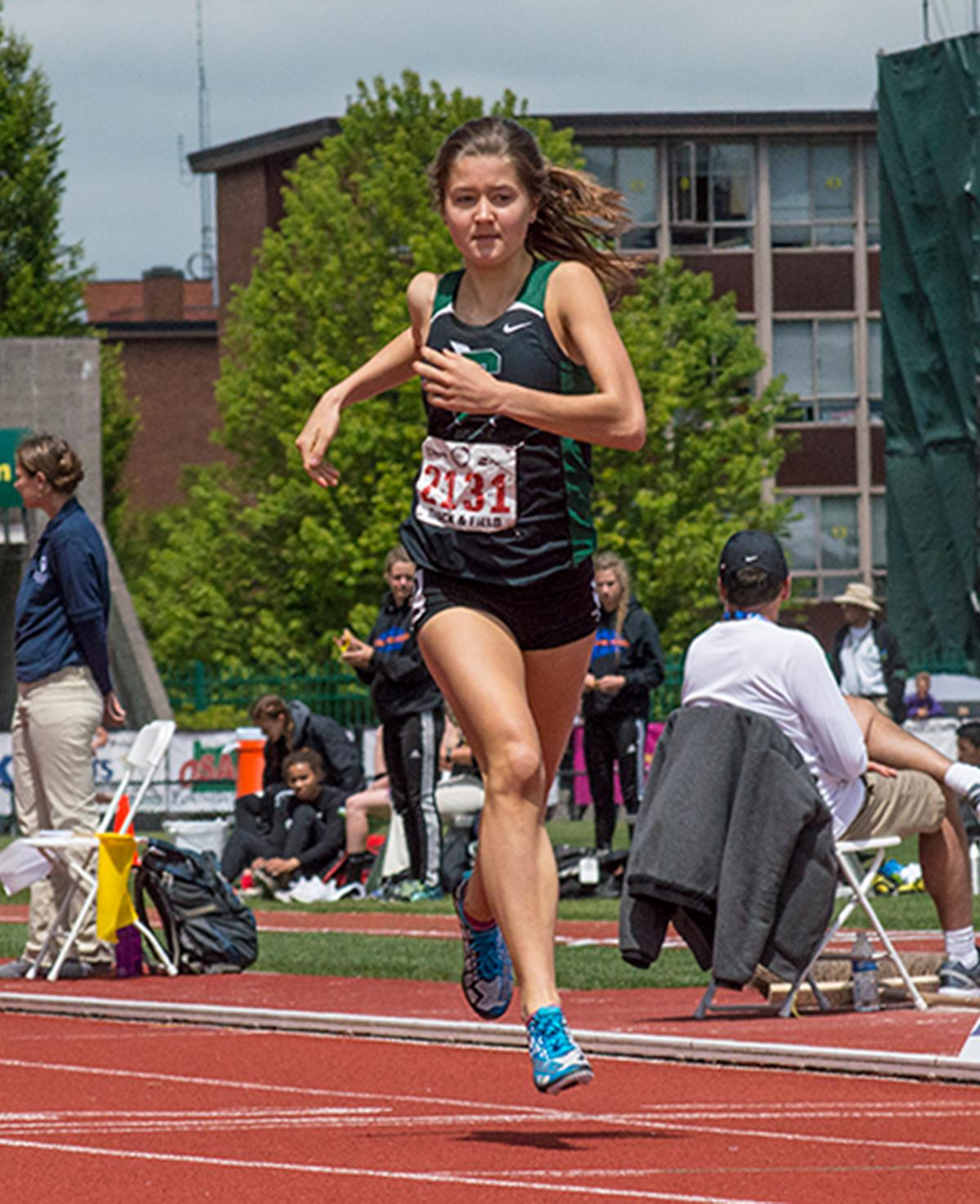 Olivia Brooks of Summit High School coasts to the finish line of the 5A Girls 1500 Meter race. She takes first place with a time of 4:30.71 at the OSAA Track and Field Championships at Hayward Field. Photo by Emily Gonzalez, Oregon News Lab.